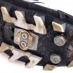 Deep, widely-spaced lugs shed mud easily, while toe spikes offer additional traction.