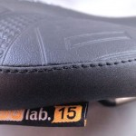 Reinforcements protect high-wear areas. The number on the tag indicates the saddle's width.